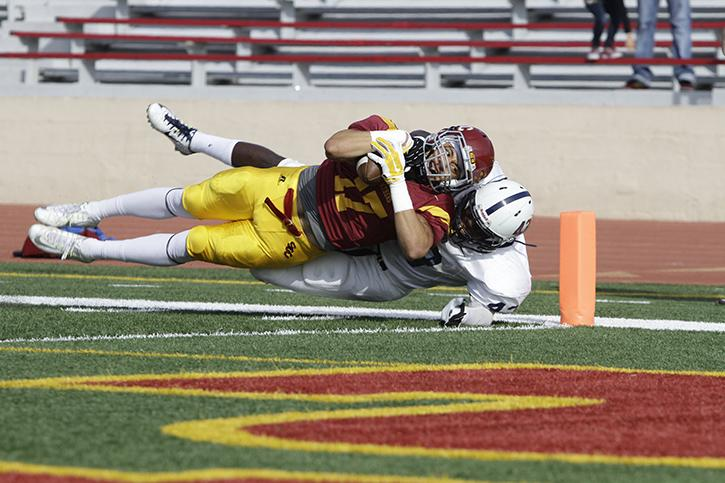 Former ARC linebacker Lawerence Hall stops a Sacramento City College player from scoring a touchdown during last seasons game on Nov. 15, 2014. ARC won the game 44-23 and must win the game Saturday to have any chance of making the playoffs. (File Photo)