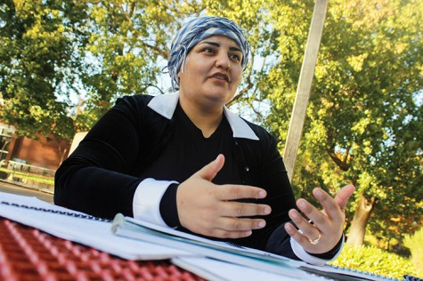 American River College student Mahjabeen Zazai sits with the lesson plans she used when she taught English in her native country of Afghanistan. Zazai said she has encountered some prejudice in America. (Photo by John Ferrannini)