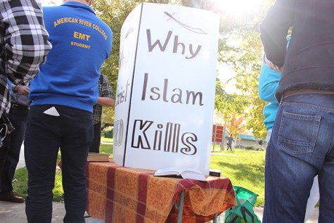 A sign reading 'Why Islam Kills' sits near the Student Center on Tuesday. The sign sparked discussions between ARC students — many of them Muslims themselves — and anti-Muslim activists. (Photo by Barbara Harvey)