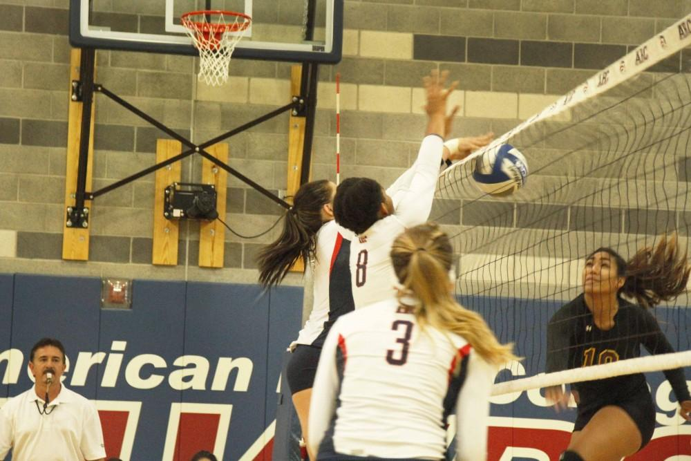 Sophomore middle blocker Erianna Williams, number 8, and freshman outside hitter Candice Reynoso, left of Williams, block a spike attempt by Hartnell sophomore Neysha Laumatia. ARC won 3-2 and also won their second match of the doubleheader against Lassen College. (Photo By Kameron Schmid)