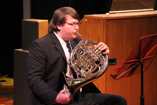 Peter Carter-Grassly  plays the french horn in an applied music recital at American River College. The next recital will take place on Thursday. (Photo by Michael Pacheco)