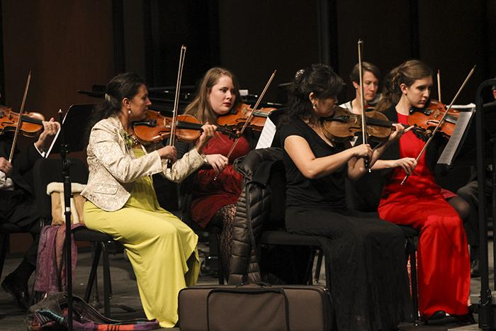 The violin section of the American River College orchestra performs a song for a winter concert. The concert was held on Dec. 2. (Photo by Michael Pacheco)