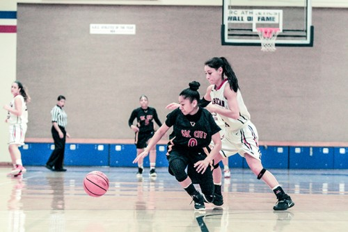 American River College guard Sariah Loudon  and Sacramento City College point guard Corina Tacardon fight for possession of the ball, during a game at ARC on Tuesday. ARC lost to Sac City 45-41. (Photo by Tyler M. Jackson)