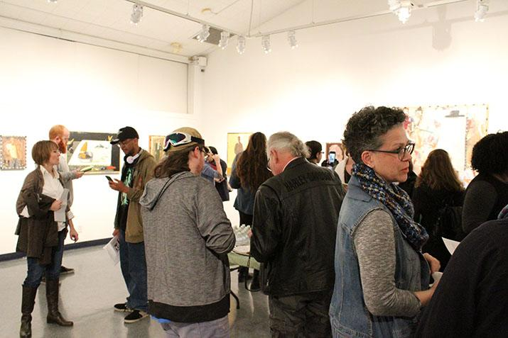 Students+attend+the+Kaneko+Gallery+reception+featuring+Jack+Ogden+and+his+artwork+on+Thursday%2C+which+is+on+display+at+American+River+College+in+from+Jan.+14+through+Feb.+10.+%28Photo+by+Timon+Barkley%29