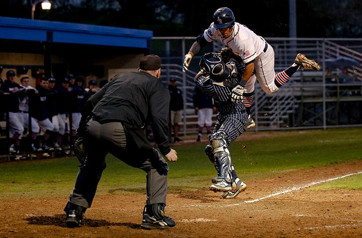 ARC+outfielder+Justin+Jordan+flies+through+the+air+while+being+tagged+at+home+by+the+West+Valley+College+catcher+on+Jan.28%2C+2016+at+American+River+College+in+Sacramento+Calif.The+game+was+ARC%27s+season+opener%2C+hosing+West+Valley+College+where+ARC+ended+up+losing+7-6.+%28Photo+by+Kyle+Elsasser%29