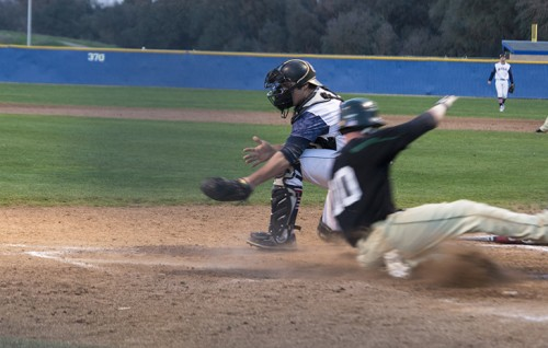 Peter Shearer of Feather River College scores the winning run against American River College in the bottom of the 13th inning at ARC. ARC lost the game 7-6. (Photo by Joe Padilla)
