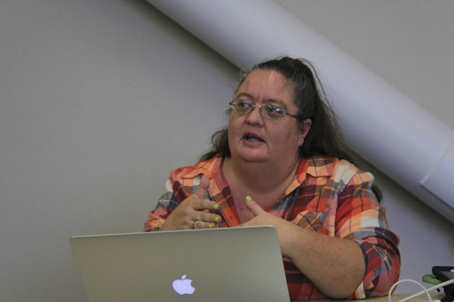 Director of Communications Tami Dunning disusses a propossed bill at the Feb. 18, 2016 Student Senate meeting. Dunning also noted additional information on the cancellation of March in March, though the board had no further comment. (Photo by Robert Hansen)