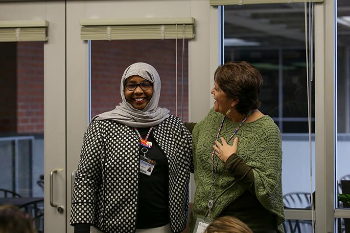 EOP and CARE coordinator Diane Delgado (right) talks about award recipient Faryal A. Said (left). Deserving teachers were presented with an award Thursday that was voted on by students at American River College. (Photo by Kyle Elsasser)