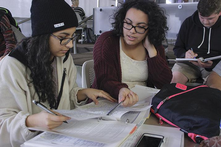 Amirah Arabi (left), Aminah Arabi (center), and Matthew Spencer (right) study together at the Student Center on the American River College campus in Sacramento, California on Feb.9, 2016. (Photo by Hannah Darden)