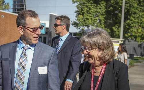 American River College Dean of planning, research and technology Adam Karp speaks with an accreditation committee member during last fall's committee visit. The school was commended in seven areas. (File Photo)