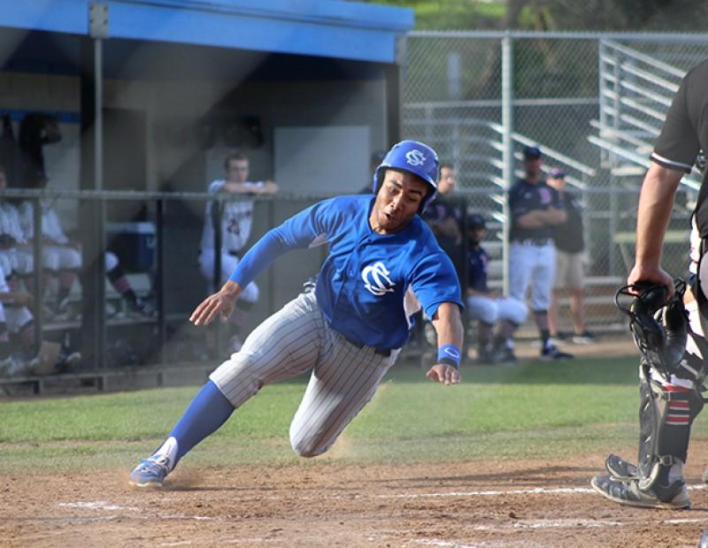 Solano 1B Evan Faccenda dives towards home plate scoring a run against ARC on Tuesday. ARC lost 6-5. (Photo by Mack Ervin III)