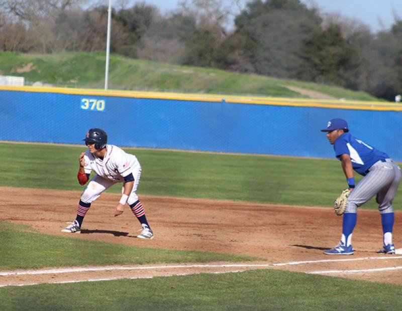 American River College OF  Mike Hatfield leads off from Solano 1B Evan Faccenda during their game on Tuesday. ARC lost 6-5. (Photo by Mack Ervin III)