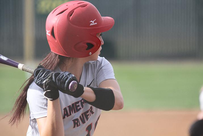 American River college catcher Katie Kapler prepares to swing at a ball during a game against Lassen College at ARC on Thursday Feb. 25, 2016. ARC won 6-3. (Photo by Jordan Schauberger)