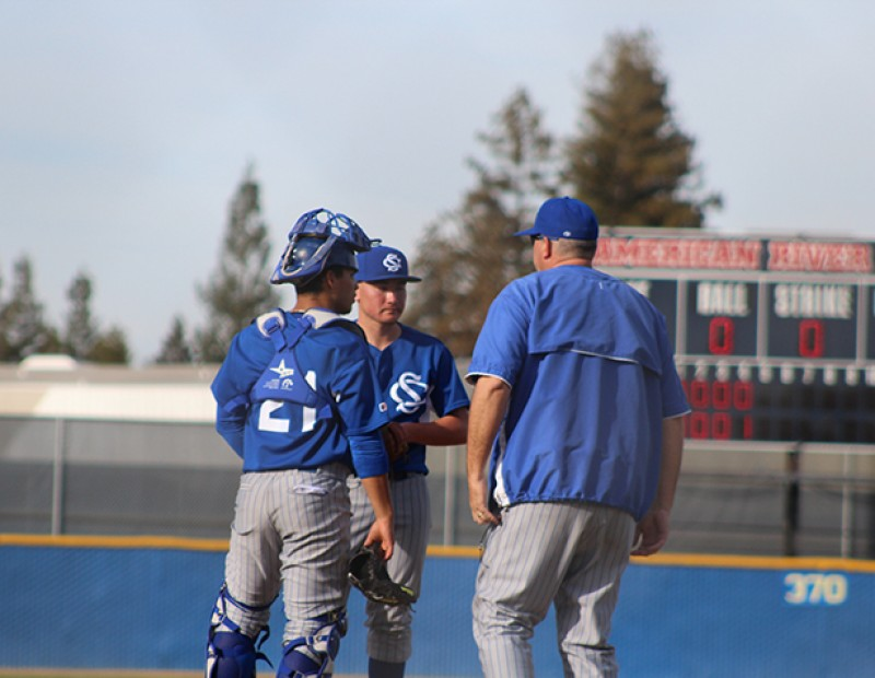 Solano P David Hostler and C Andres Quijada talk with a coach after allowing a run, two walks, and a hit batter during the fourth inning of Tuesday's game against American River College. ARC lost 6-5. (Photo by Mack Ervin III)