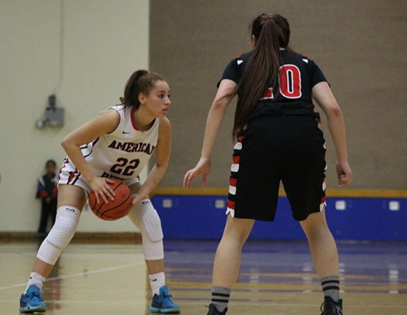 American River College guard Halle Hamre holds onto the ball while Skyline's Alyssa Dela Cruz defends during a playoff game on Wednesday Feb. 24, 2016. ARC lost 78-59. (Photo by Mack Ervin III)