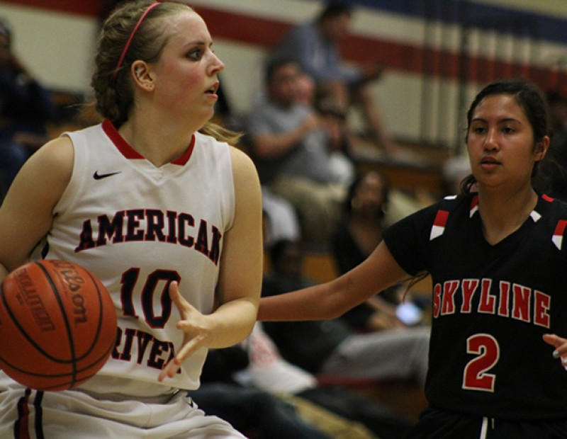 American River College forward Brie Richins protects the ball from Skyline's Ariana Sheehy during a playoff game on Wednesday Feb. 24, 2016. ARC lost 78-59. (Photo by Mack Ervin III)