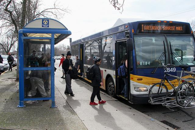 Students board a Sacramento Regional Transit bus directly in front of the American River College campus. RT released a plan to raise fares that would include eliminating the paratransit monthly pass, among other changes. (File Photo)