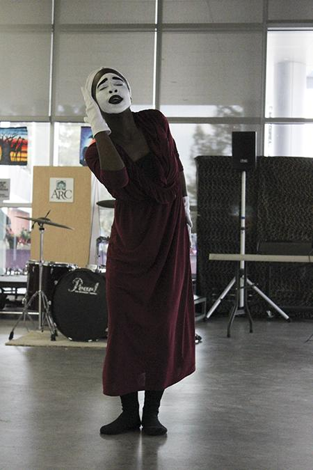 Praise dancer April Collins in mid praise dance during the black heritage celebration in the student center on Feb. 25. By Allante Morris