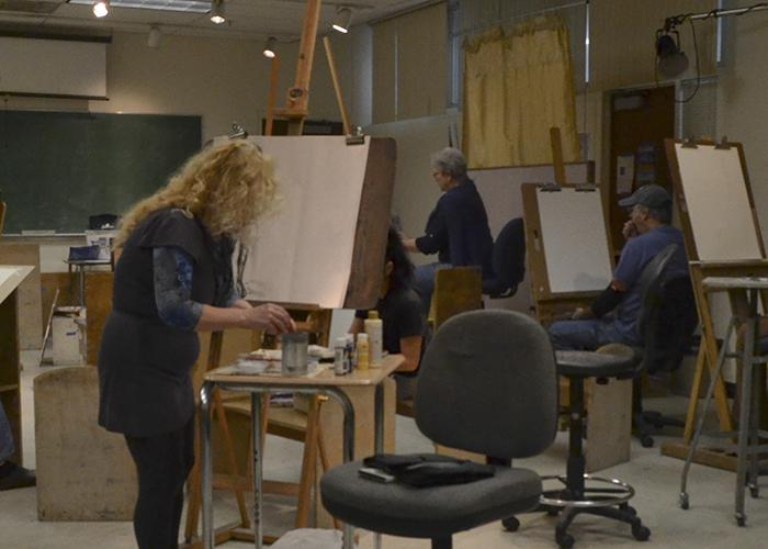 Artists setting up for their figure drawing session at American River College on Friday. The 'Figure Friday' event is a weekly workshop for students and staff. (Photo by Sharriyona Platt)