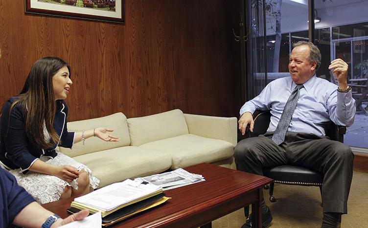 American River College representative Eugenia Torres (left) speaks with California State Assemblyman Bill Dodd in his office at the capitol in Sacramento, California on Monday, Feb. 29, 2016. The delegation from ARC lobbied for a bill that would fund mental health services at public California colleges. (Photo by Hannah Darden)