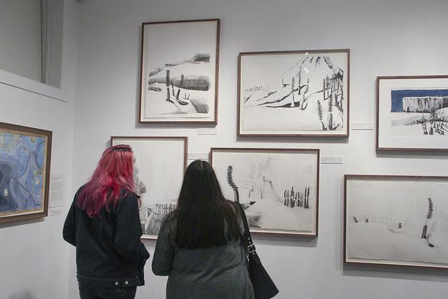 Inoa Spyres (left) and Salina Herrera-Spyres (right) observe art by Kathy Aoki at the James Kaneko Gallery on March 3, 2016. (Photo by Hannah Darden)