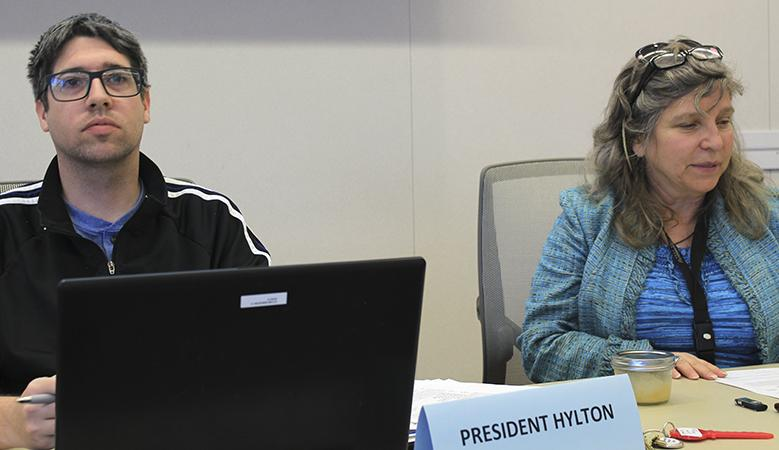 Senate President David Hylton II and Director of Legislative Affairs Laurie Jones listen to board discussion at the March 15 Student Senate meeting. Funds for students attending NCORE were a major discussion at the meeting. (Photo by Robert Hansen)