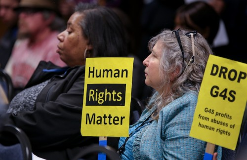 American River College senator Laurie Jones holds up a sign that reads 'Human Rights Matter' during a Sacramento Regional Transit board meeting Monday. The RT board approved a 10% fare increase for July 2016. (Photo by Kyle Elsasser)