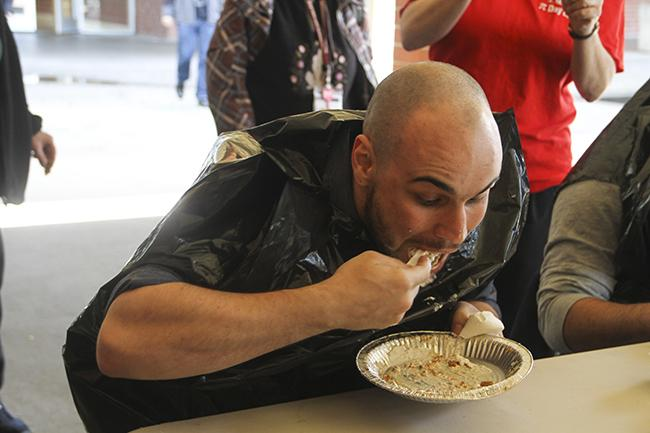 Garey Hollenbeck, Math Club President at American River College participated in the pie eating and won on March 14, 2016.  (Photo by Bailey Carpenter)