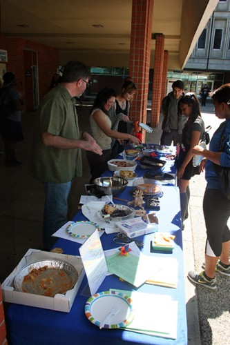 Students line up for a slice of pie at last years Pi Day, March 12, 2014. (Photo by Alexander Panasenko)