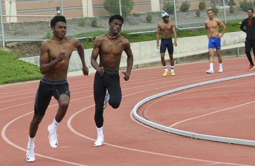 Isaiah Griffin (center left) runs during track and field practice on March 10, 2016 at the American River College Beavers stadium. Griffin has seriously progressed during his time at ARC to become one of the team's top sprinters. (Photo by Itzin Alpizar)