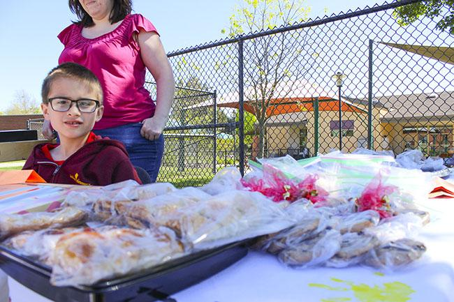 American River College's Child Development Center runs a bake sale in front of their building on Mar. 30, 2016  (Photo by Timon Barkley)