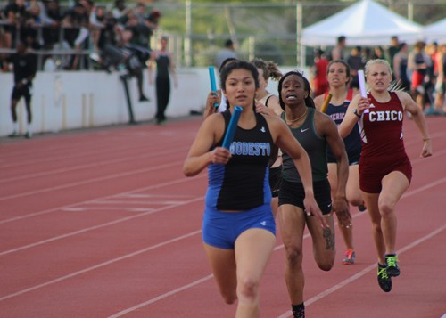 Modesto Junior College runner Mariajose Correa leads the pack during the 2nd leg of the women's 4x400m relay race at the American River Invitational on March 26, 2016 at American River College. Correa and the Modesto team finished 3rd with a time of 4:00.84. (Photo by Mack Ervin III)