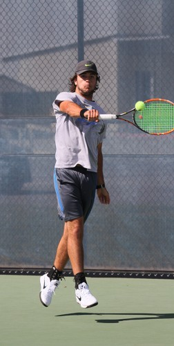 American River College men's tennis player Dylan King leaps to return the ball during practice on Mar. 30, 2016 at ARC. The team is preparing for the BIG 8 North Conference Tournament this Thursday Santa Rosa, California. (Photo by Matthew Nobert)