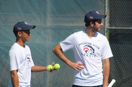 American River College teammates Cody Duong (left) and TJ Aukland (right) talk in between points during a game against Santa Rosa Junior College on March 15, 2016 at ARC. Duong and Aukland won the game 8-1. (Photo by Mack Ervin III)