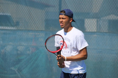 American River College's Kadyn Silva warms up before a doubles match against Santa Rosa Junior College on March 15, 2016 at ARC. Silva and his partner Alex Meliuk won the match 8-2. (Photo by Mack Ervin III)