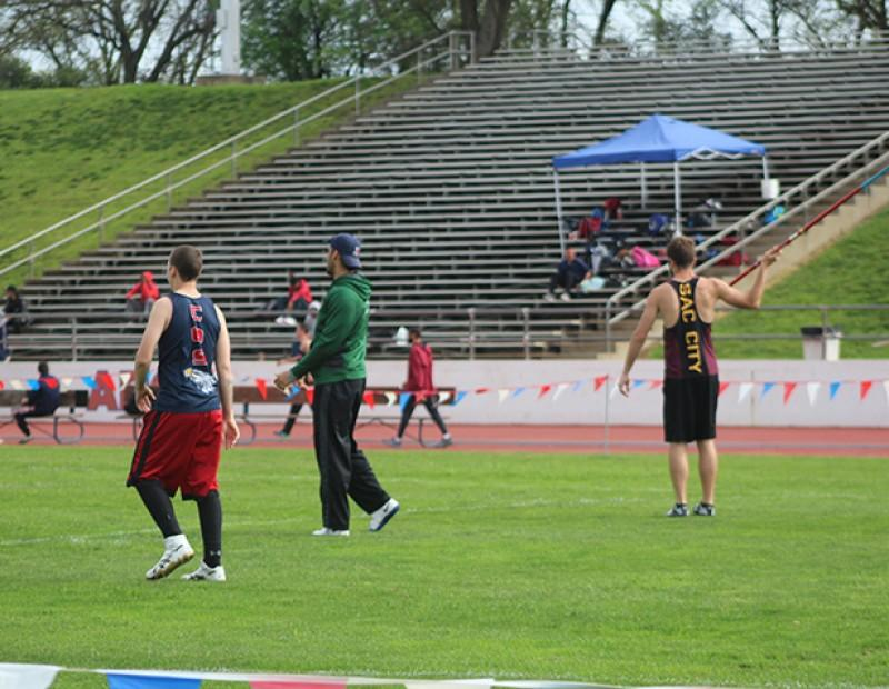 Javelin throwers from College of the Siskiyous, Diablo Valley, and Sacramento City College warm up before the javelin event at the 31st annual Beaver Relays on March 4th, 2016 at American River College. Michael Martin of Siskiyous won the event with a throw of 193 feet and 6 inches. (Photo by Matthew Nobert)