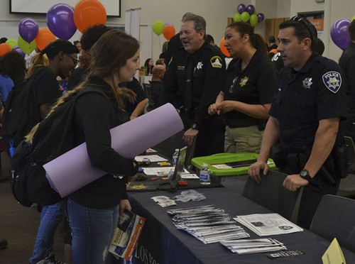 The Los Rios Police Department speaks with students during the career fair at American River College on April 7.  (Photo by Sharriyona Platt)