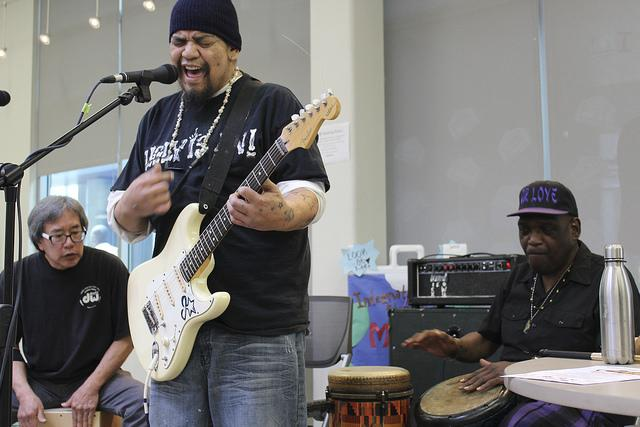 James Estrella plays an original song with Eric Chun and Ron Carson backing him up with percussion during the Acoustic cafe held at American River College on April 1, 2016. Acoustic cafe is hosted by Eric Chun. (Photo by Robert Hansen)