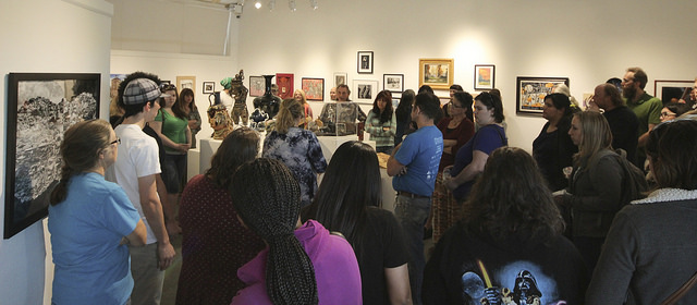 A group of students, staff, faculty and community members gather at the student art show at the James Kaneko Gallery at American River College in Sacramento, California on April 26. The show runs from April 25 to May 11. (Photo by Hannah Darden)