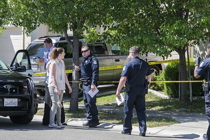 Police talk to local residents at the site of a shooting in Natomas on April 18, 2016.The shooting injured one man and caused the lockdown of nearby Merryhill Preschool. (Photo by Joe Padilla)