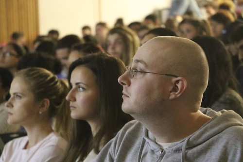 American River College student James Puppolo (right) sits in a packed Raef Hall on April 21, 2016 to listen to lecture from Steve Running on the effects of climate change and career opportunities in the STEM field. Running was a board member of the Intergovernmental Panel on Climate Change (IPCC) what it was awarded the Nobel Peace Prize, along with former Vice President Al Gore in 2007. (Photo by Jordan Schauberger)