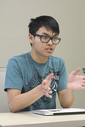 Sen. Kevin Phan explains his resolution suggesting the Los Rios Police Department add more police on campus at the Student Senate meeting Thursday. Debate between board members lasted nearly 20 minutes before voting was postponed. (Photo by Robert Hansen)
