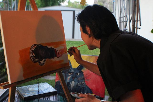 Rachel Marthaler paints her new artwork she is working on for her sister at her house in Orangevale Ca on April 24. (By Allante Morris)