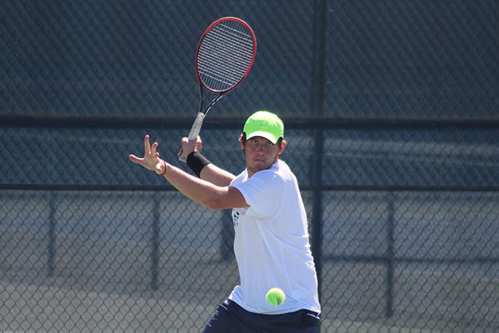 American River College's Alex Meliuk prepares to swing at a ball during a playoff match against #8 ranked Modesto Junior College on April 5, 2016 at ARC. Meliuk and the #1 ranked Beavers advanced to the semifinals after a 5-0 win. (Photo by Mack Ervin III)