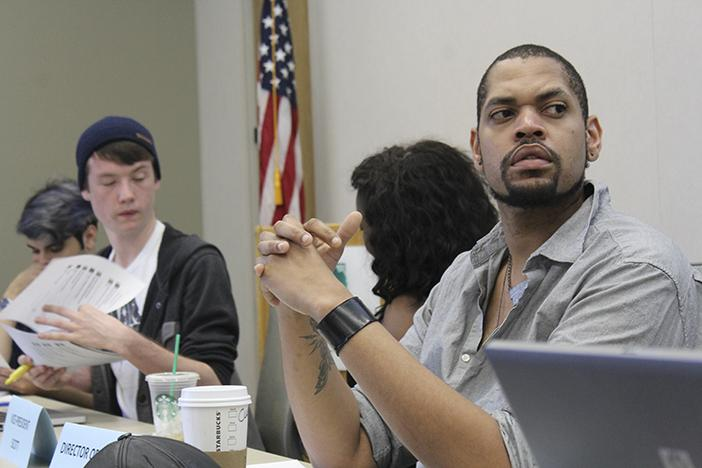(From right) American River College Senate director of finance Jeremy Diefenbacher, CAEB President Justin Nicholson, and Senator James Cortright listen to Dalhia Salem explain the proposed Advocacy in April event that is to replace March in March. At the Student Senate meeting on March 31, 2016. (Photo by Robert Hansen)