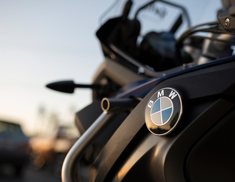 A BMW emblem on Burak Kocal's BMW motorcycle. Kocal is a member of the Sactown Sinners, a motorcycle club featuring bikes from the Sacramento area. (Photo by Kyle Elsasser)
