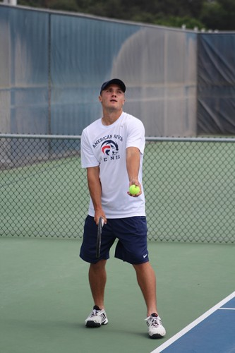 American River College's Sean McDaniel serves a ball during a doubles match against Hunter Kettering and Tony Lin of Chabot College on April 11, 2016. McDaniel and his partner Cody Duong won the match 8-5. (Photo by Mack Ervin III)