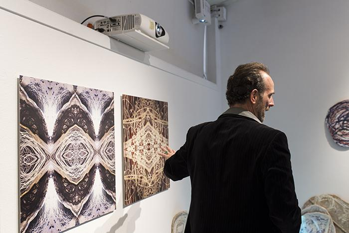 Anthony Maki Gill describes his digital ceramic hybrid prints to audience members at the