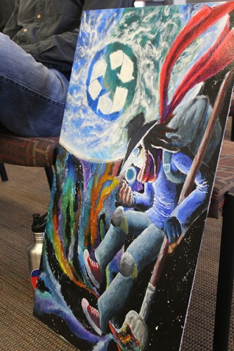 The winning artwork for ARC's ‪#‎UPcycle‬ ‪#‎REcycle‬ bin project brought at the Associated Student Body Joint Budget Committee meeting on April 28, 2016. The Upcycle project has renovated the old recycle bins. (Photo by Robert Hansen)
