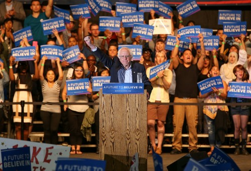 Presidential candidate Bernie Sanders salutes the crowd after finishing his rally at Bonney Field in Sacramento, California on May 9 2016. (Photo by Kyle Elsasser)